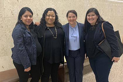 Law students Emma Hulse and Yesenia Pulido in L.A. Superior Court with client and mother after a successful hearing for Special Immigrant Juvenile Status.