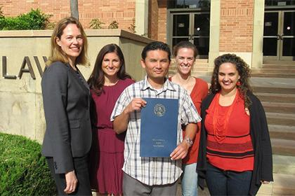Members of UCLA Law's Criminal Defense Clinic stand with their client Phal Sok.