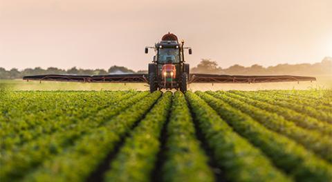 tracker in field of crops