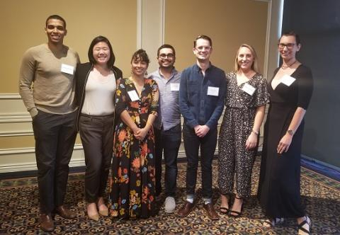 Ajwang Rading '20, Michelle Xu '19, Claudia Peña '08, Luis Vasquez '19, Ian Grady '19, Alyson Tocicki '20 and Sunney Poyner '19 celebrate at the Student Leadership Breakfast.