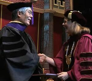UCLA Law professor Hiroshi Motomura accepts an honorary degree from Loyola University New Orleans president Tania Tetlow on May 11.
