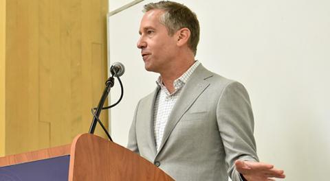 Kal Raustiala at speaker podium
