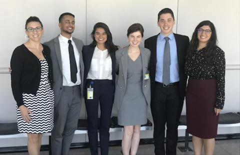 Alicia Virani '11 (far right) stands with members of the Bail Practicum in 2019. UCLA Law clinics have participated in a lawsuit seeking to protect prisoners during the COVID-19 crisis.